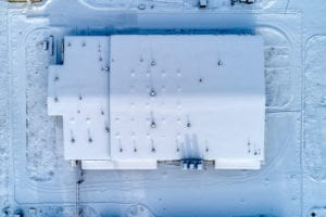 warehouse commercial building snow covered roofing epdm